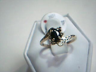 Blue Stone Lady's Stone & Diamond Ring 4 Diamonds .04 Carat T.W.