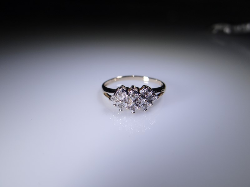 Lady's Diamond Cluster Ring 10 Diamonds .10 Carat T.W. 10K Yellow Gold 1.5g