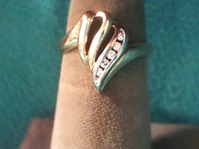Lady's Diamond Fashion Ring 5 Diamonds .05 Carat T.W. 10K Yellow Gold 1.5dwt