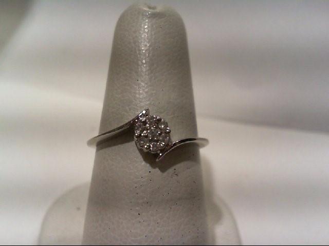 Lady's Diamond Fashion Ring 7 Diamonds .14 Carat T.W. 14K White Gold 1.7g