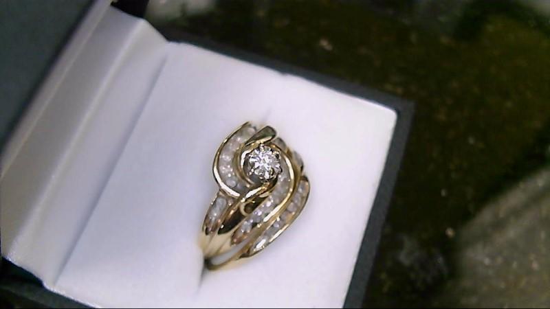 Lady's 10k yellow gold round diamond wed set