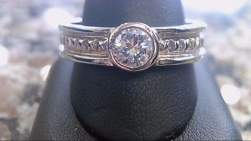 Lady's Diamond Solitaire Ring .63 CT. 14K White Gold 7.8g Size:14.5