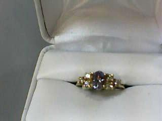 Tanzanite Lady's Stone & Diamond Ring 6 Diamonds .24 Carat T.W. 14K Yellow Gold