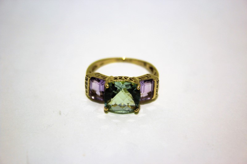 Teal Stone Lady's Stone & Diamond Ring 8 Diamonds .08 Carat T.W.