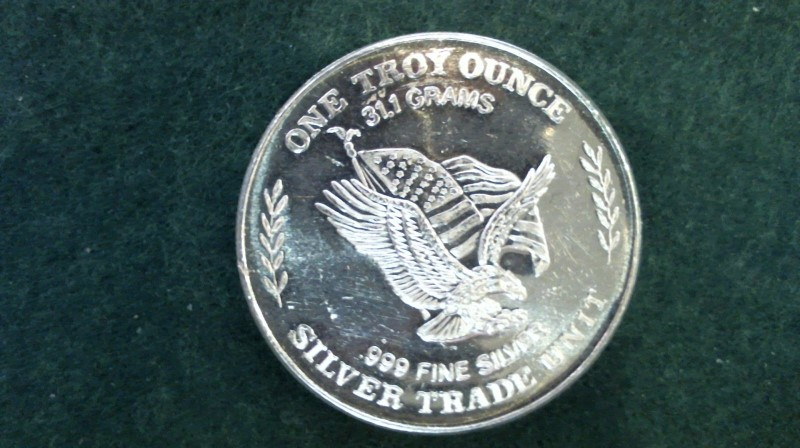 A Silver Bullion .999 SILVER BULLION ONE TROY OUNCE