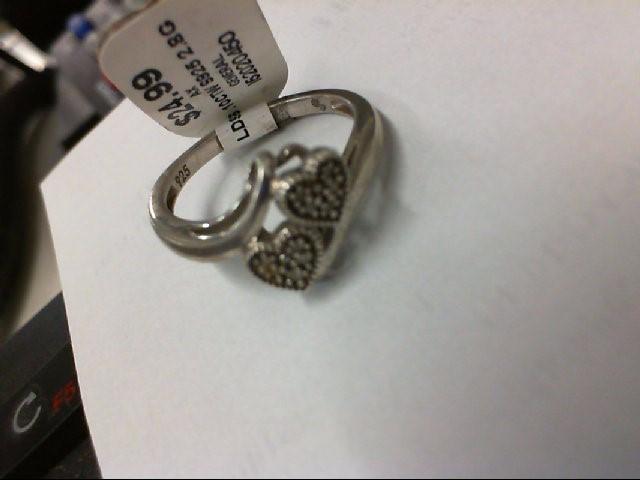 Lady's Silver-Diamond Ring 10 Diamonds .10 Carat T.W. 925 Silver 2.8g