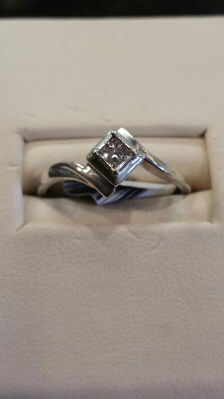 Lady's Silver-Diamond Ring 4 Diamonds .20 Carat T.W. 925 Silver 0.9dwt