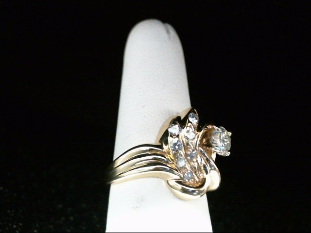 Lady's Diamond Fashion Ring 8 Diamonds .78 Carat T.W. 14K Yellow Gold 7.5g