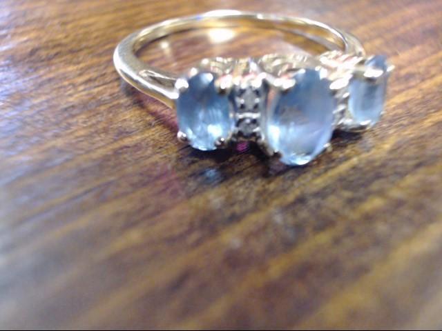 Blue Stone Lady's Stone & Diamond Ring 4 Diamonds .004 Carat T.W.