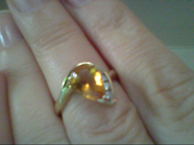 Yellow Stone Lady's Stone & Diamond Ring 3 Diamonds .06 Carat T.W.