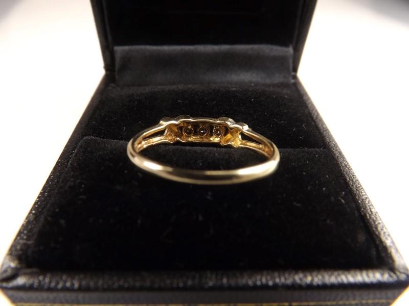 Lady's Diamond Fashion Ring 3 Diamonds APX .12 Carat T.W. 10K Yellow Gold 1.7g
