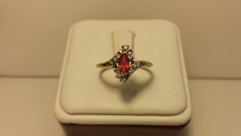 10k Yellow Gold Ring with 1 Red Stone and 12 Diamond Chips - 1.3dwt - Size 7