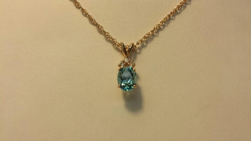 10k Yellow Gold Necklace and Pendant with 1 Oval Blue Stone and 3 Diamonds