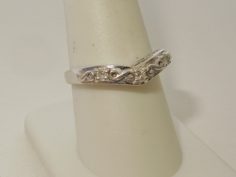 Lady's Diamond Fashion Ring 3 Diamonds .15 Carat T.W. 10K White Gold 2.1g