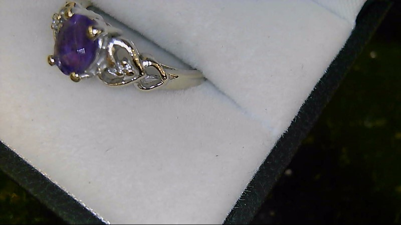 Lady's 14k white gold oval amethyst -2-1mm round diamonds sz 6.5 ring