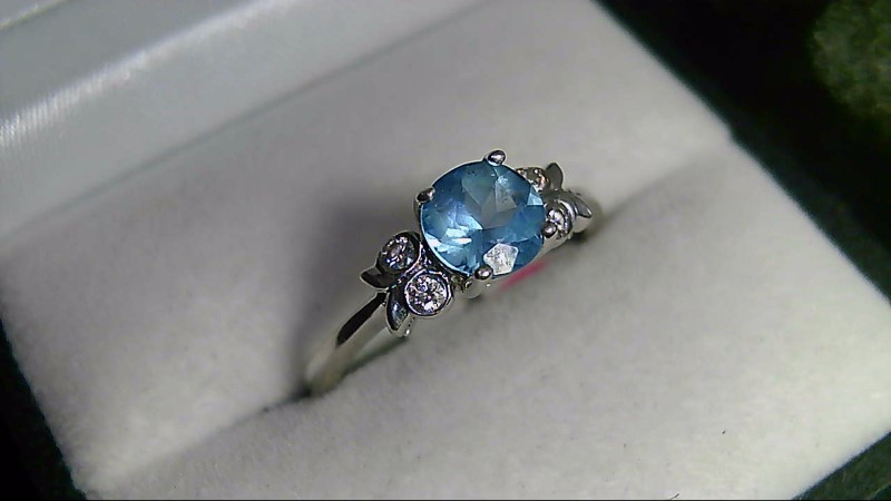 lady's 14k white gold round sky blue topaz diamond ring