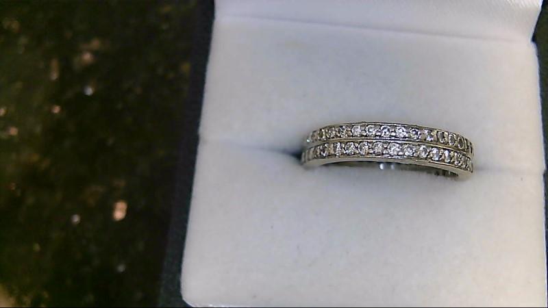 Lady's 14k white gold 1/2ct center with round diamonds eternity set sz 7