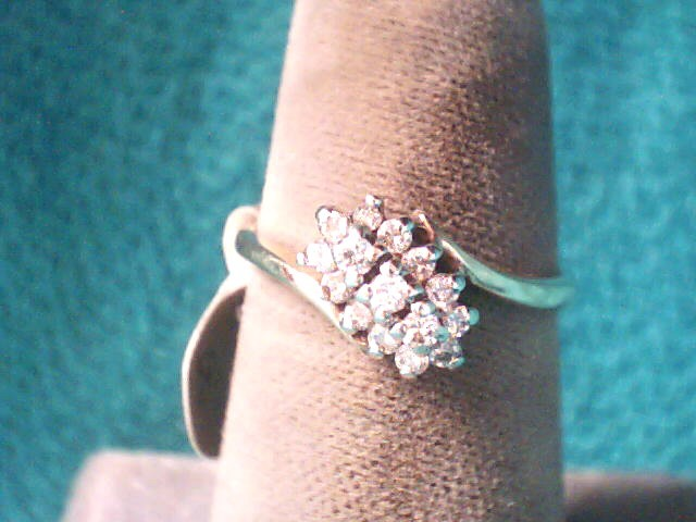 Lady's Diamond Cluster Ring 15 Diamonds .21 Carat T.W. 14K Yellow Gold 1.6dwt
