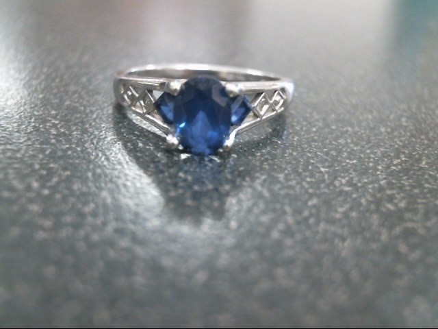 Blue Stone Lady's Stone & Diamond Ring 2 Diamonds .02 Carat T.W. 10K White Gold