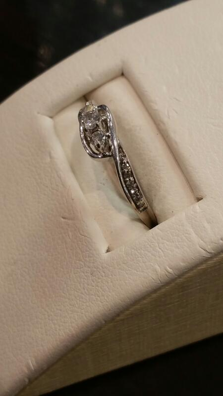 Lady's Diamond Fashion Ring 3 Diamonds .09 Carat T.W. 10K White Gold 0.8dwt