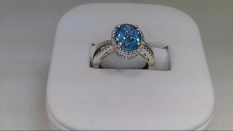 Lady's sterling silver size 5 oval blue topaz with 4 -1mm cz's