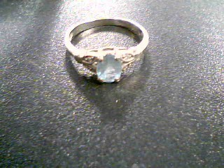 Synthetic Aquamarine Lady's Stone & Diamond Ring 4 Diamonds .04 Carat T.W.