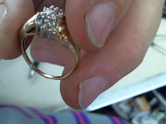 Lady's Diamond Fashion Ring 3 Diamonds .03 Carat T.W. 10K Yellow Gold 2.4g