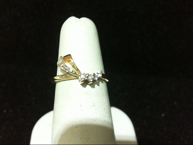 Lady's Diamond Fashion Ring 7 Diamonds .10 Carat T.W. 10K Yellow Gold 1.4g