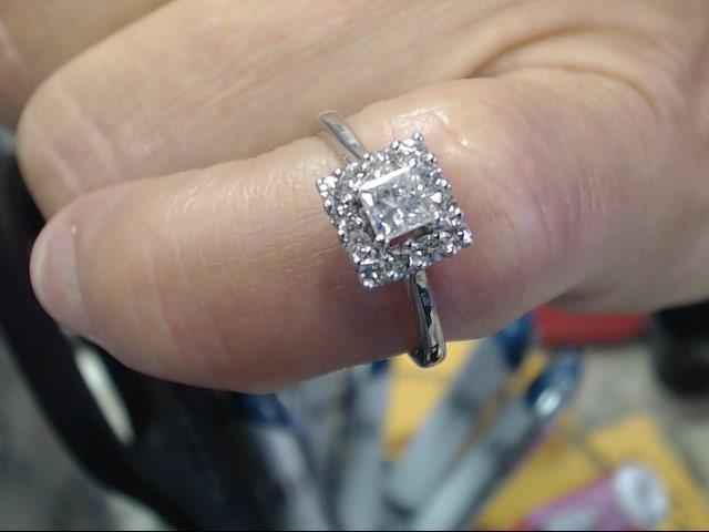 Lady's Diamond Fashion Ring 13 Diamonds .55 Carat T.W. 14K White Gold 1.9dwt