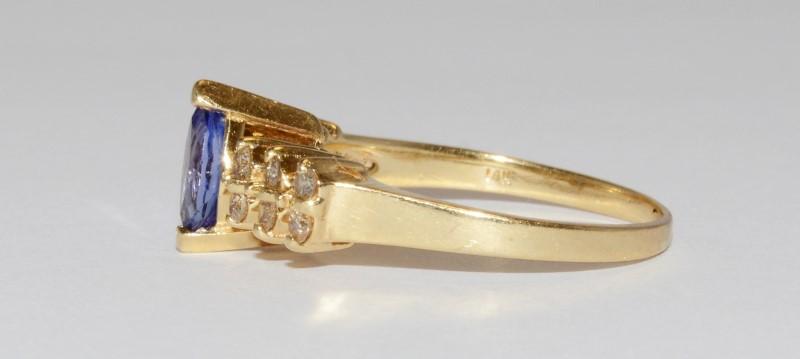 Tanzanite & Diamond Ring set in 14K Size: 9