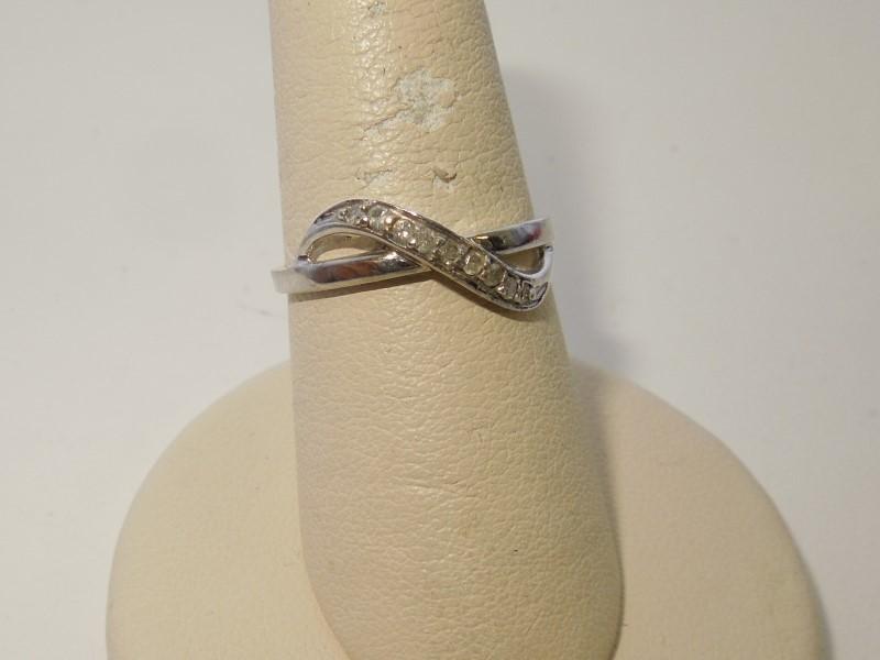 Lady's Diamond Fashion Ring 9 Diamonds .18 Carat T.W. 10K White Gold 1.8g