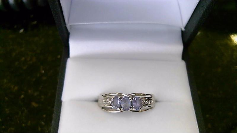 Lady's 10k white gold tanzanite/dia ring