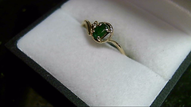 lady's oval emerald w/rd dia 10k yellow gold