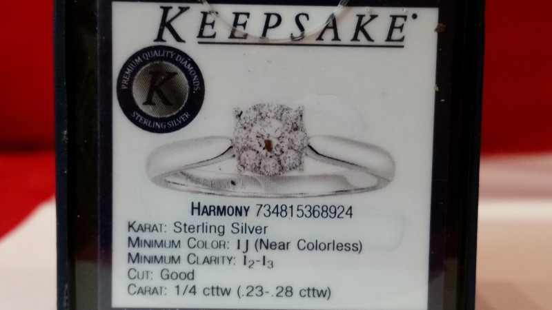 Lady's Silver-Diamond Ring 9 Diamonds .26 Carat T.W. 925 Silver 2.07g Size:7