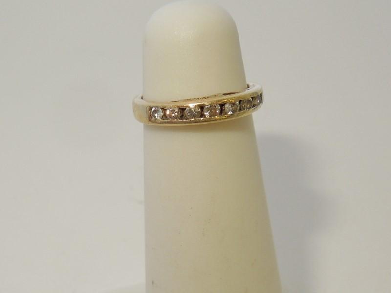 Lady's Diamond Fashion Ring 8 Diamonds .08 Carat T.W. 14K Yellow Gold 1.3g