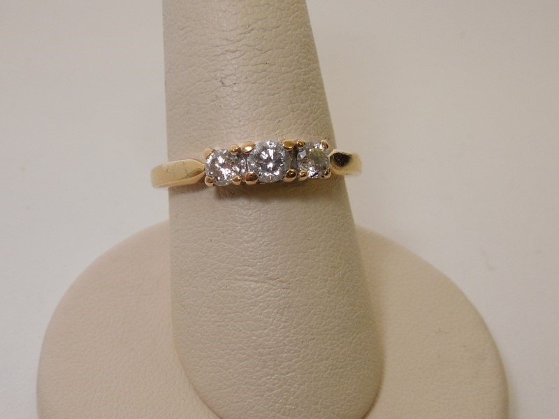 Lady's Diamond Fashion Ring 3 Diamonds .50 Carat T.W. 18K Yellow Gold 4.3g