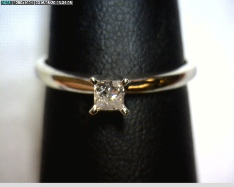 Lady's Diamond Solitaire Ring .14 CT. 10K White Gold 1.21dwt Size:7