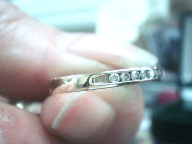 Lady's Diamond Wedding Band 11 Diamonds .22 Carat T.W. 14K Yellow Gold 1.4dwt