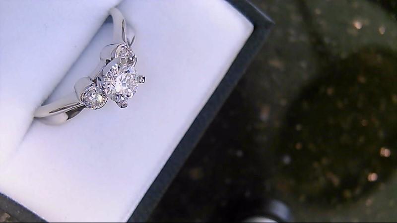 lady's 14k white gold 1/2ct mine cut diamond with 2 bezel set diamonds
