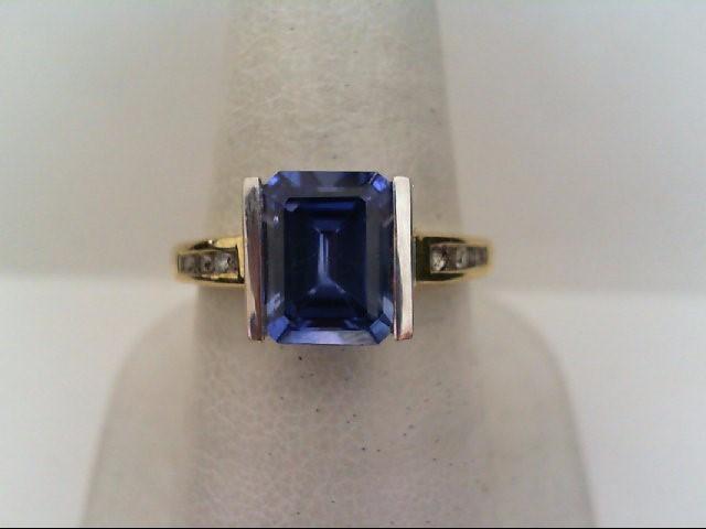 Synthetic Tanzanite Lady's Stone & Diamond Ring 6 Diamonds .12 Carat T.W.