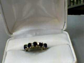 Sapphire Lady's Stone & Diamond Ring 8 Diamonds .040 Carat T.W. 14K Yellow Gold