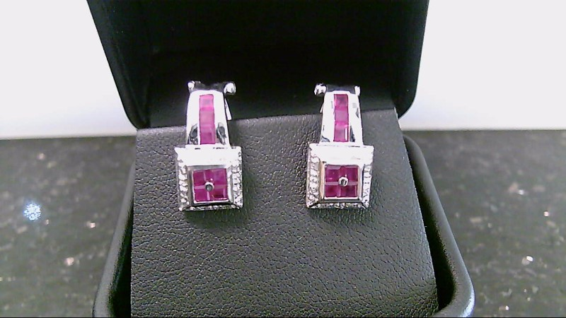 Lady's 14k white gold genuine princess cut and round diamond earrins