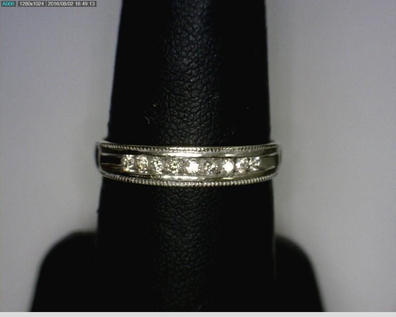 Lady's Diamond Wedding Band 9 Diamonds .09 Carat T.W. 14K White Gold 1.71dwt