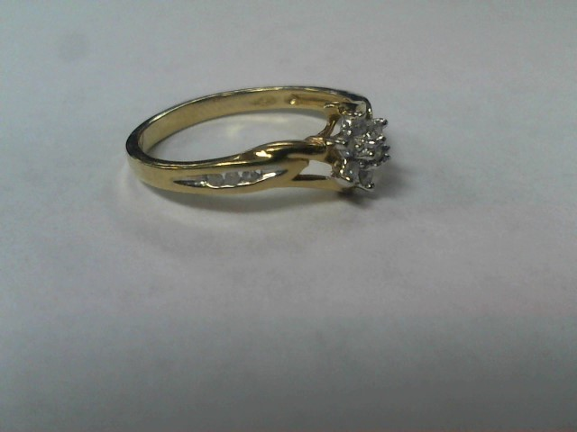 Lady's Diamond Cluster Ring 12 Diamonds .12 Carat T.W. 10K Yellow Gold 1.7g
