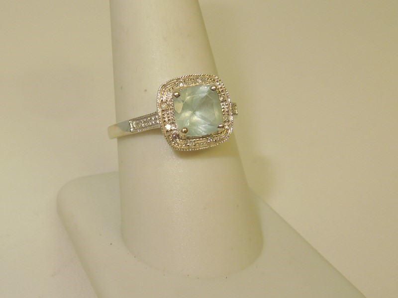 Synthetic Aquamarine Lady's Stone & Diamond Ring 12 Diamonds .060 Carat T.W.