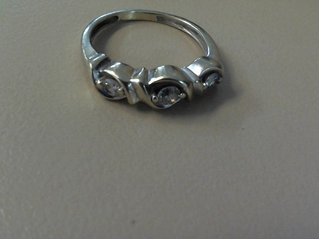 Lady's Diamond Fashion Ring 3 Diamonds .20 Carat T.W. 10K White Gold 1.6dwt