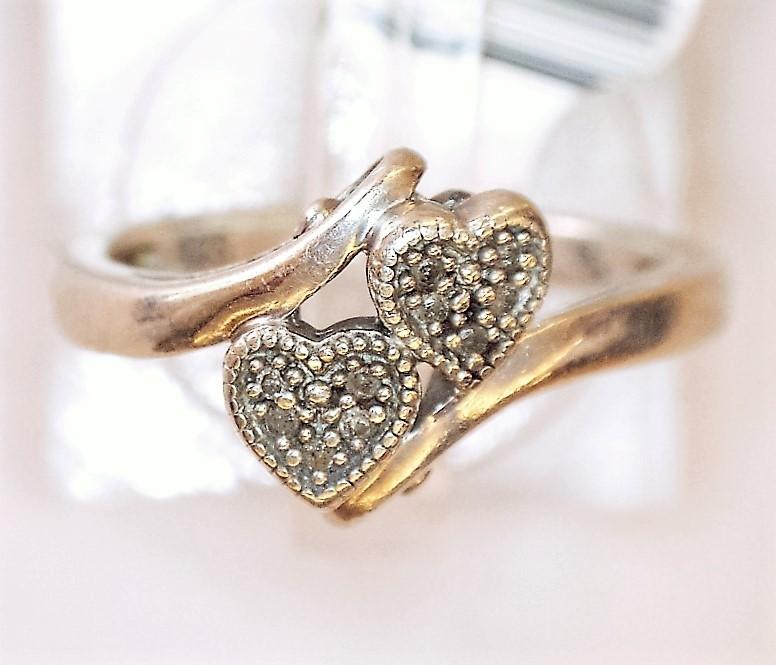 Lady's Silver-Diamond Ring 10 Diamonds .10 Carat T.W. 925 Silver 1.97dwt