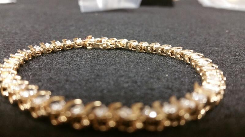 Gold-Diamond Bracelet 39 Diamonds 1.17 Carat T.W. 10K Yellow Gold 5.6dwt
