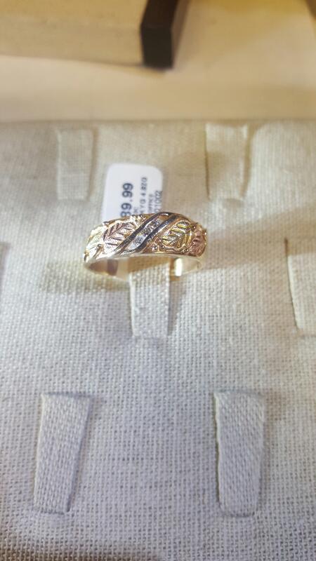 Lady's Diamond Fashion Ring 3 Diamonds .03 Carat T.W. 10K Yellow Gold 4.82g