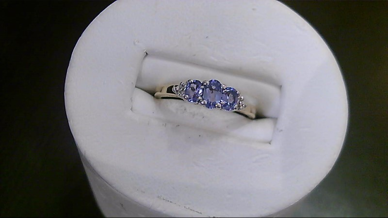 Tanzanite Lady's Stone & Diamond Ring 4 Diamonds .04 Carat T.W. 10K Yellow Gold